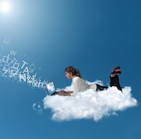 Businesswoman over a cloud